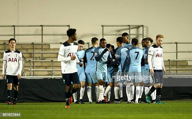 Paolo Fernandes of Manchester City celebrates his goal with team mates during the Premier League 2 match between Manchester City and Tottenham...
