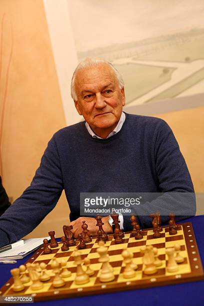 Paolo Fresco former CEO of Fiat sits in front of a chessboard at the Centro Congressi of the Industrial Union in the occasion of a synchronized chess...