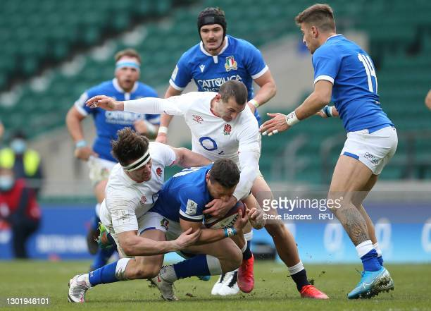 Paolo Garbisi of Italy is tackled by Jonny May and Tom Curry of England during the Guinness Six Nations match between England and Italy at Twickenham...