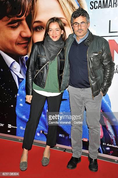 Paolo Genovese and Federica Rizzo walk a red carpet for 'La Cena Di Natale' on November 22, 2016 in Rome, Italy.