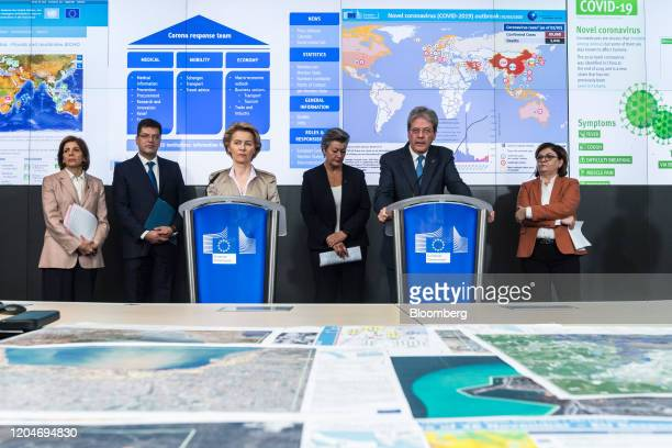 Paolo Gentiloni, financial affairs minister for the European Commission, right, speaks from a podium beside and Ursula von der Leyen, president of...
