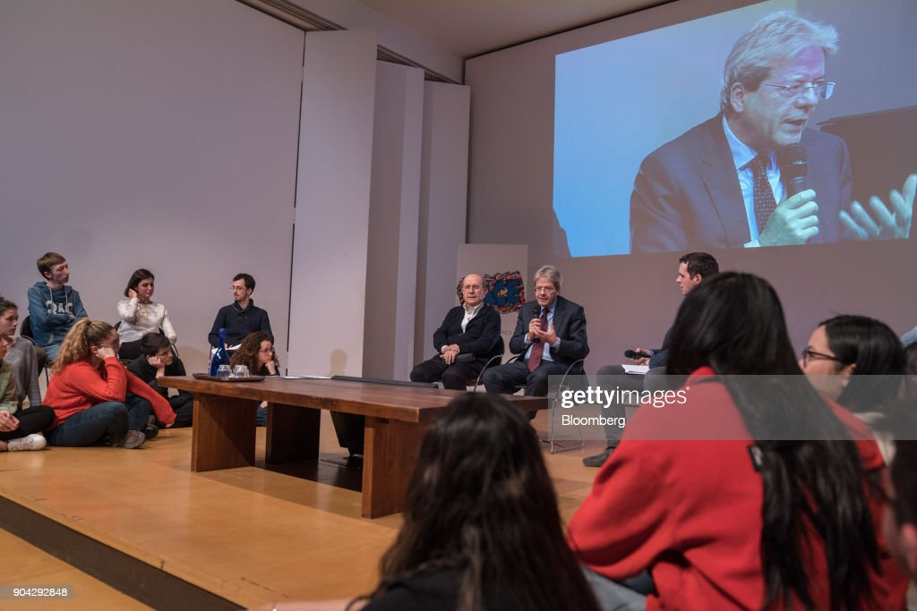 Paolo Gentiloni, Italy's prime minister, center, speaks during a meeting with young voters in Turin, Italy, on Friday, Jan. 12, 2018. Italians vote on March 4 in an election pitting mainstream parties against populists and euro-skeptics. Photographer: Federico Bernini/Bloomberg via Getty Images