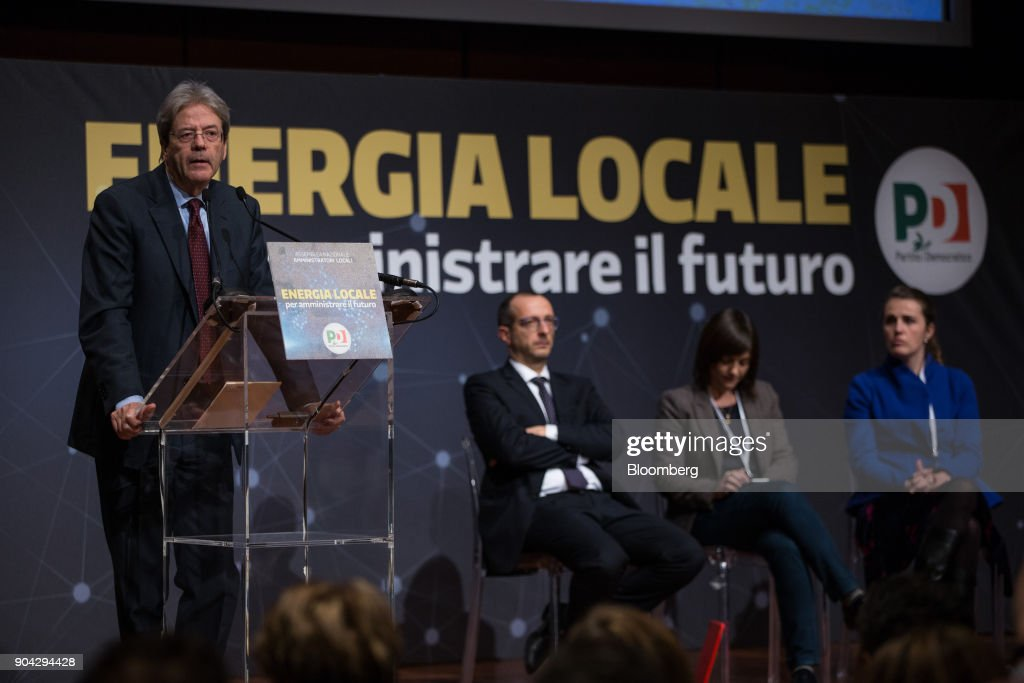 Paolo Gentiloni, Italy's prime minister, left, speaks during a meeting with local administrators in Turin, Italy, on Friday, Jan. 12, 2018. Italians vote on March 4 in an election pitting mainstream parties against populists and euro-skeptics. Photographer: Federico Bernini/Bloomberg via Getty Images