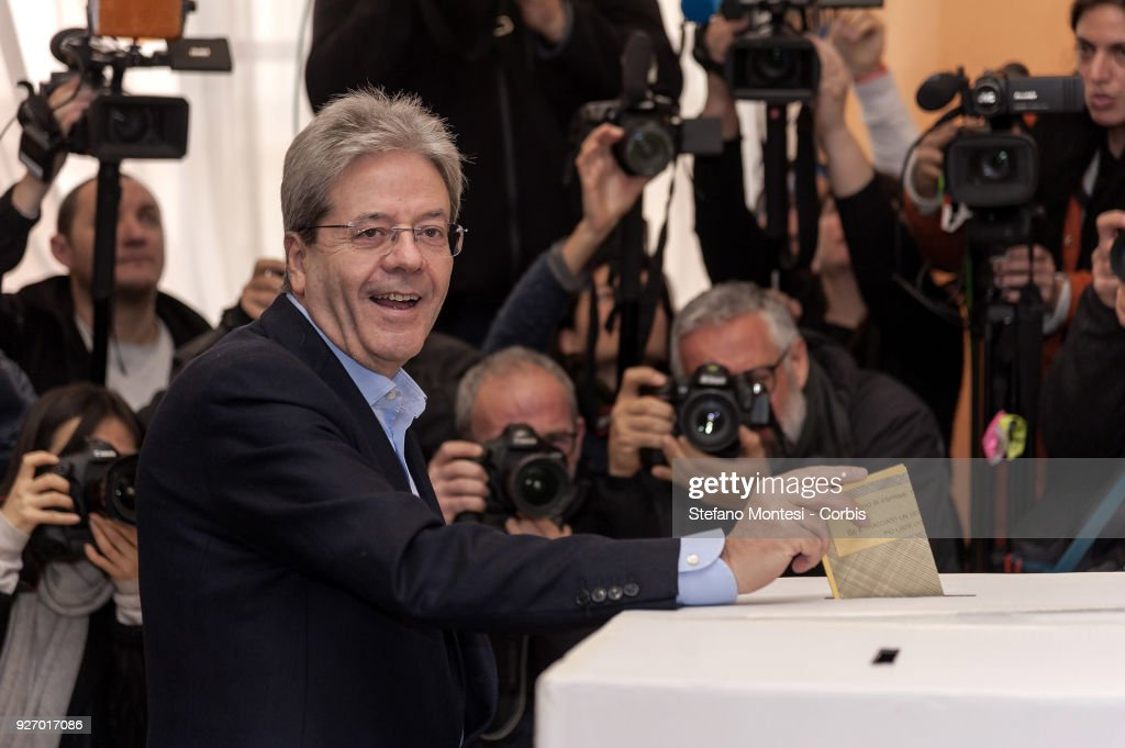 Paolo Gentiloni, Italy's prime minister, votes in the general election on March 4, 2018 in Rome Italy. The economy and immigration are key factors in the 2018 Italian General Election after parliament was dissolved in December 2017. Campaigning on the right are Silvio Berlusconi of Forza Italia teaming up with Matteo Salvini of the Eurosceptic Lega. While on the centre-left is Matteo Renzi, leader of the Democratic Party. Challenging both camps is the leader of the Five Star Movement, Luigi Di Maio. (Photo by Stefano Montesi - Corbis/Corbis via Getty Images))