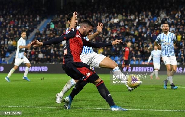 Paolo Ghiglione of Genoa CFC competes for the ball with Felipe of SPAL during the Serie A match between SPAL and Genoa CFC at Stadio Paolo Mazza on...