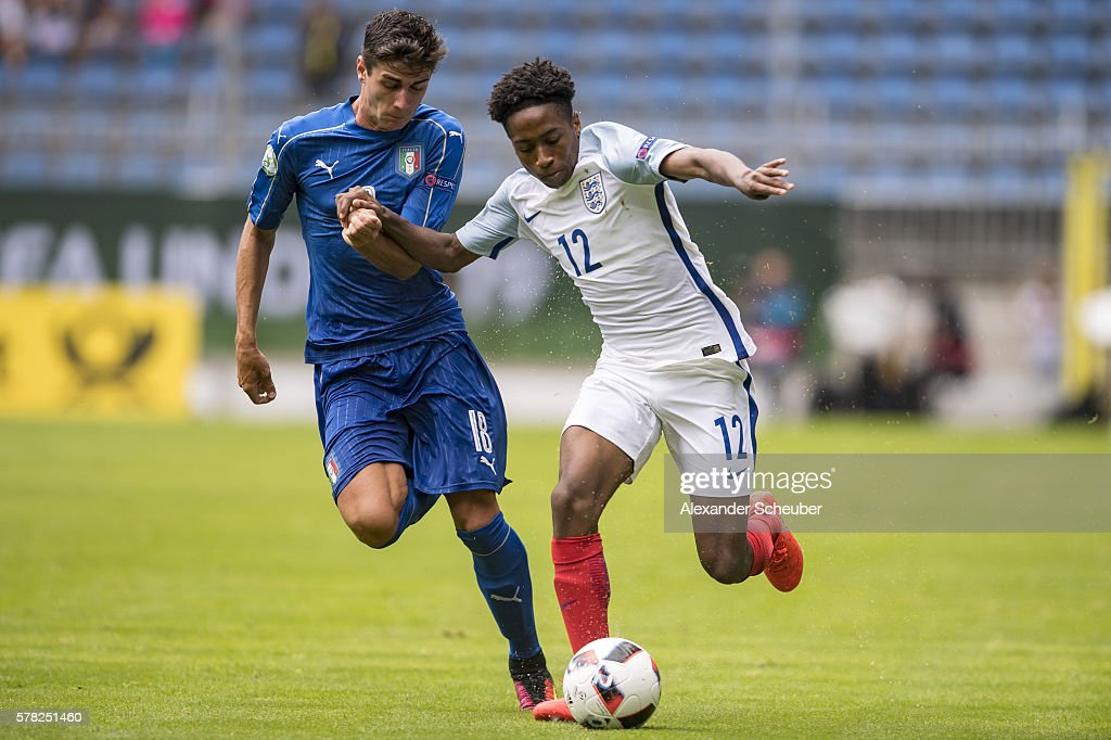Paolo Ghiglione of Italy challenges Kyle Walker-Peters of England during the U19 Match between England and Italy at Carl-Benz-Stadium on July 21, 2016 in Mannheim, Germany.