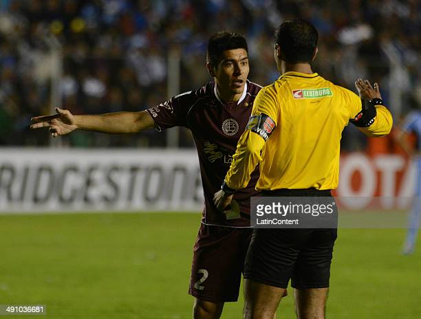 Paolo Goltz of Lanús complains to the referee during a second leg quarter final match between Bol'ívar and Lanœús as part of Copa Bridgestone...