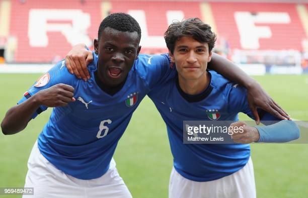Paolo Gozzi Iweru of Italy and Giuseppe Leone of Italy celebrate their win over belgium during the UEFA European Under17 Championship Semi Final...