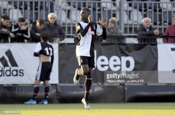 Paolo Gozzi Iweru of Juventus celebrates the victory at the end of the UEFA Youth League match between Juventus U19 and Atletico Madrid U19 on...