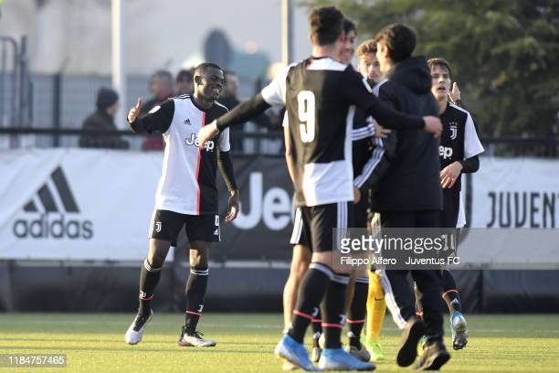 Paolo Gozzi Iweru of Juventus celebrates the victory with teammates at the end of the UEFA Youth League match between Juventus U19 and Atletico...