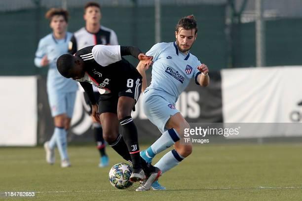 Paolo Gozzi Iweru of Juventus Turin U19 and Alberto Salido of Atletico Madrid U19 eiz# during the UEFA Youth League match between Juventus U19 and...