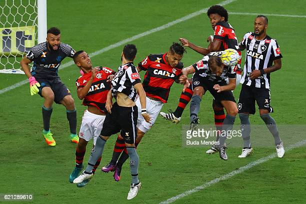 Paolo Guerrero and Jorge of Flamengo struggle for the ball with Rodrigo Pimpao and Joel Carli of Botafogo during a match between Flamengo and...