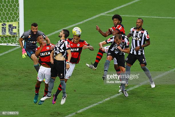Paolo Guerrero and Jorge of Flamengo struggle for the ball with Rodrigo Pimpao of Botafogo during a match between Flamengo and Botafogo as part of...