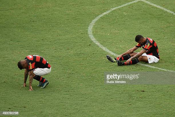 Paolo Guerrero and Kayke of Flamengo react tol a lost match between Flamengo and Internacional as part of Brasileirao Series A 2015 at Maracana...