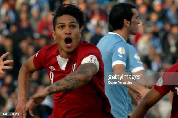 Paolo Guerrero from Peru celebrates a scored goal during a match between Uruguay and Peru as part of the sith round of the South American Qualifiers...