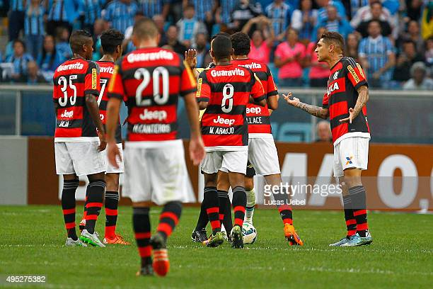 Paolo Guerrero of Flamengo argues with the referee after receives red card during the match Gremio v Flamengo as part of Brasileirao Series A 2015 at...