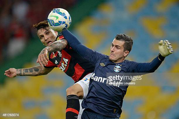 Paolo Guerrero of Flamengo battles for the ball with Marcelo Grohe of Gremio during the match between Flamengo and Gremio as part of Brasileirao...