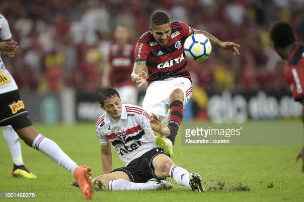 Paolo Guerrero of Flamengo struggles for the ball with Anderson Martins of Sao Paulo during the match between Flamengo and Sao Paulo as part of...