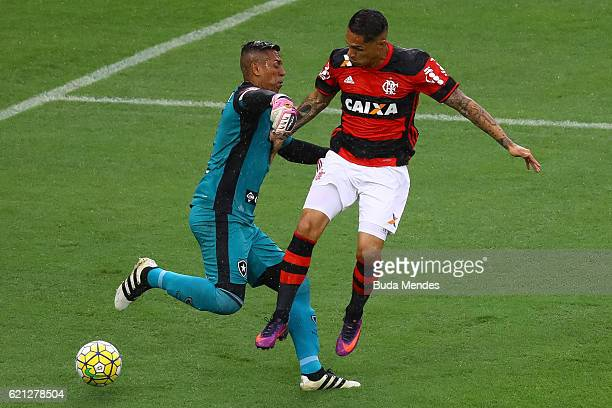 Paolo Guerrero of Flamengo struggles for the ball with goalkeeper Sidao of Botafogo during a match between Flamengo and Botafogo as part of...