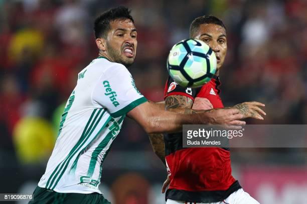 Paolo Guerrero of Flamengo struggles for the ball with Luan Garcia of Palmeiras during a match between Flamengo and Palmeiras as part of Brasileirao...