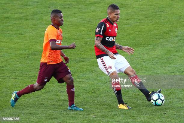 Paolo Guerrero of Flamengo struggles for the ball with Maycon Nikao of Atletico PR during a match between Flamengo and Atletico PR as part of...