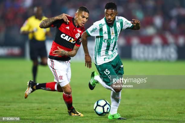 Paolo Guerrero of Flamengo struggles for the ball with Michel Bastos of Palmeiras during a match between Flamengo and Palmeiras as part of...