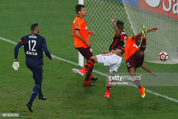 Paolo Guerrero of Flamengo struggles for the ball with Thiago Heleno of Atletico PR during a match between Flamengo and Atletico PR as part of Copa...