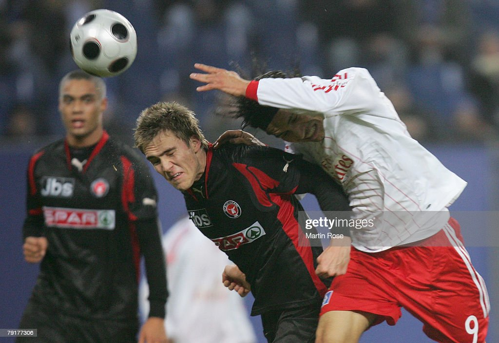 Paolo Guerrero (R) of Hamburg and Magnus Troest (L) of Midtjyland head for the ball during the friendly match between Hamburger SV and FC Midtjyland at the HSH Nordbank Arena on January 23, 2008 in Hamburg, Germany.