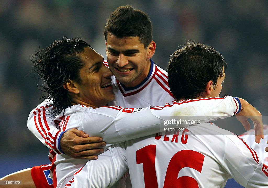 Paolo Guerrero (L) of Hamburg celebrates after he scores his team's opening goal during the Bundesliga match between Hamburger SV and 1899 Hoffenheim at Imtech Arena on November 20, 2011 in Hamburg, Germany.