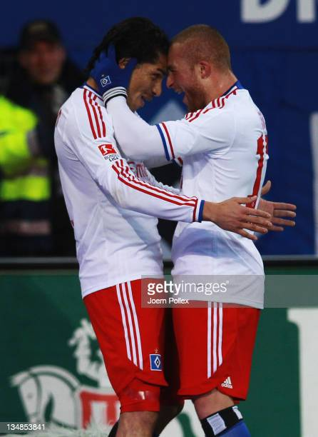 Paolo Guerrero of Hamburg celebrates with his team mate Goekhan Toere after scoring his team's first goal during the Bundesliga match between...