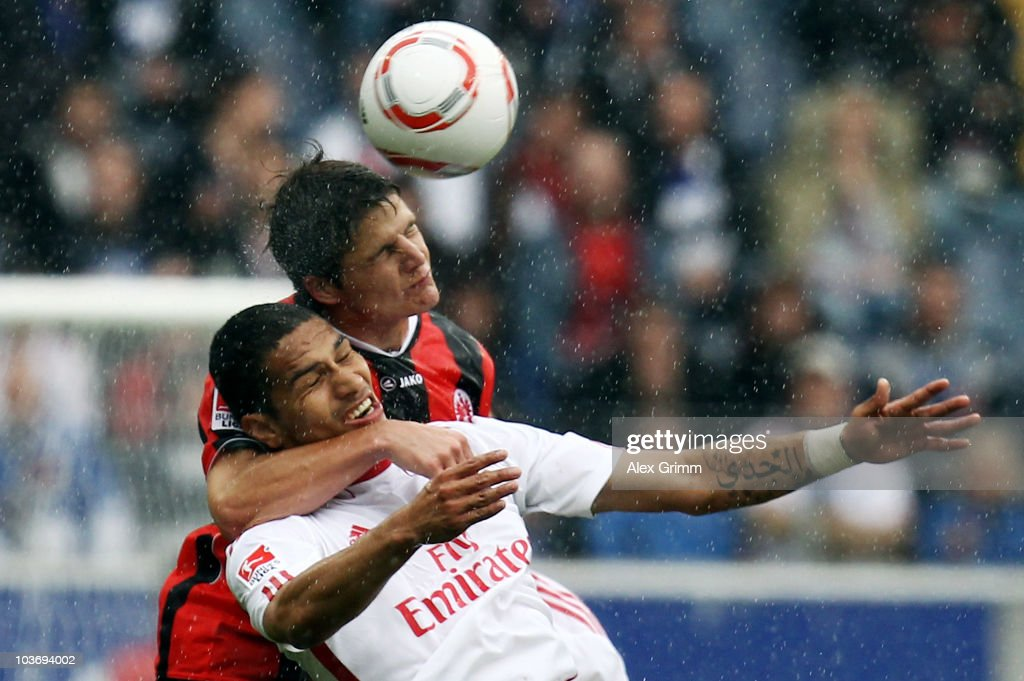 Paolo Guerrero (front) of Hamburg is challenged by Pirmin Schwegler of Frankfurt during the Bundesliga match between Eintracht Frankfurt and Hamburger SV at the Commerzbank Arena on August 28, 2010 in Frankfurt am Main, Germany.