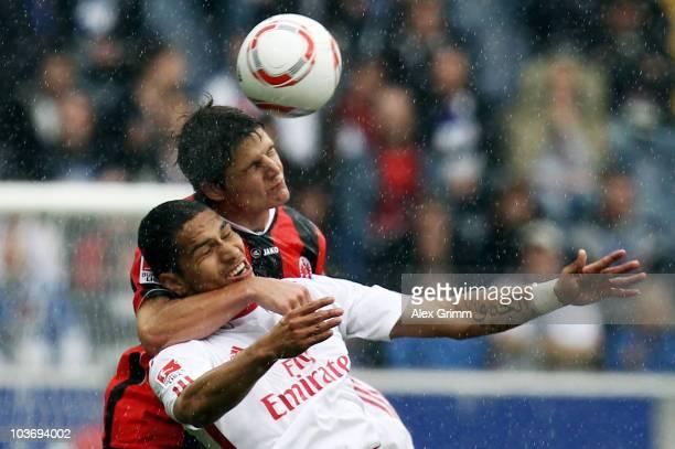 Paolo Guerrero of Hamburg is challenged by Pirmin Schwegler of Frankfurt during the Bundesliga match between Eintracht Frankfurt and Hamburger SV at...