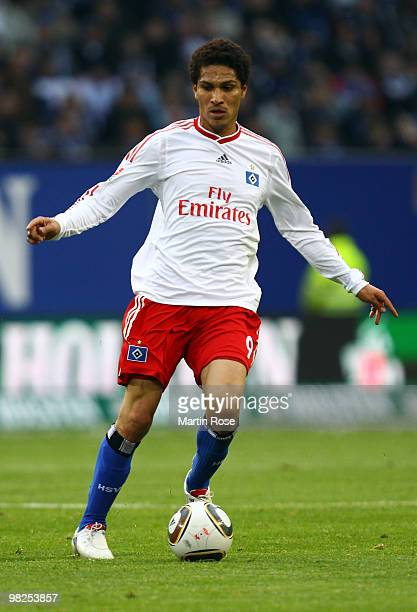 Paolo Guerrero of Hamburg runs with the ball during the Bundesliga match between Hamburger SV and Hannover 96 at HSH Nordbank Arena on April 4 2010...