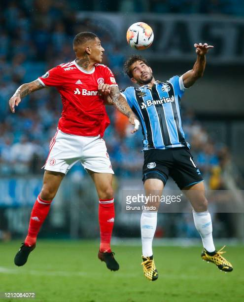 Paolo Guerrero of Internacional and Lucas Silva of Gremio fight for the ball during the match for the Copa CONMEBOL Libertadores 2020 at Arena do...