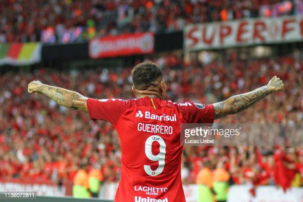 Paolo Guerrero of Internacional celebrates after scoring the third goal of his team during the match between Internacional v Palestino as part of...