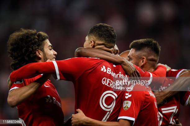 Paolo Guerrero of Internacional celebrates with teammates after scoring the second goal of his team during a match between Internacional and Nacional...