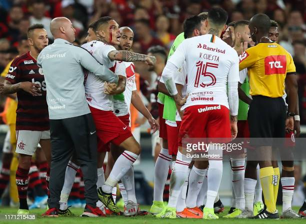 Paolo Guerrero of Internacional with a face injury reacts with the referee after receiving red card during a match between Flamengo and Internacional...
