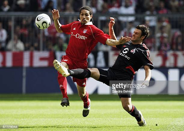 Paolo Guerrero of Munich and Oezalan Alpay of Cologne fight for the ball during the Bundesliga match between FC Bayern Munich and 1 FC Cologne at the...