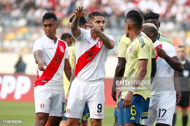 Paolo Guerrero of Peru argues with players of Colombia during a friendly match between Peru and Colombia at Estadio Monumental de Lima on June 9 2019...