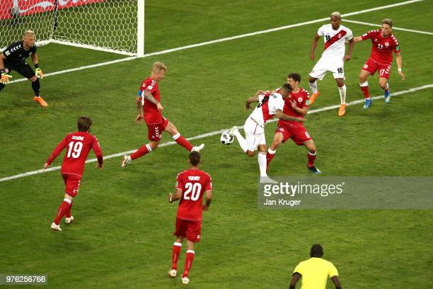 Paolo Guerrero of Peru attempts to control the ball as Simon Kjaer of Denmark blocks during the 2018 FIFA World Cup Russia group C match between Peru...