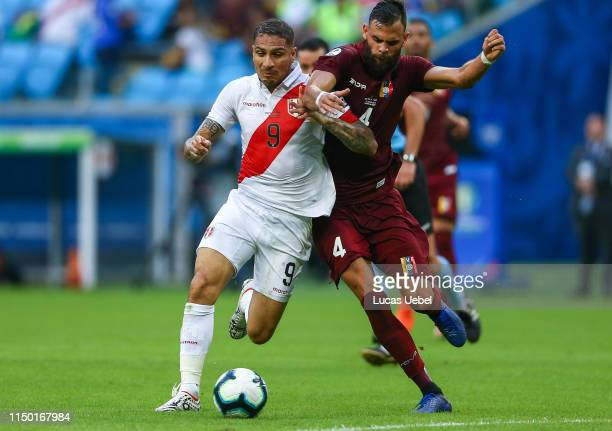Paolo Guerrero of Peru battles for the ball against Jhon Chancellor of Venezuela during the Copa America Brazil 2019 Group A match between Venezuela...