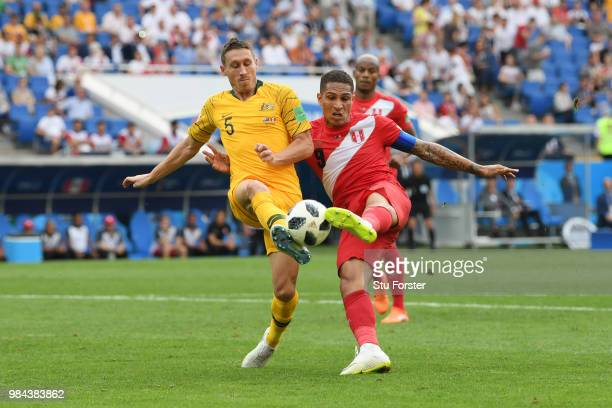 Paolo Guerrero of Peru beats Mark Milligan of Australia to the ball to score his sides second goal during the 2018 FIFA World Cup Russia group C...