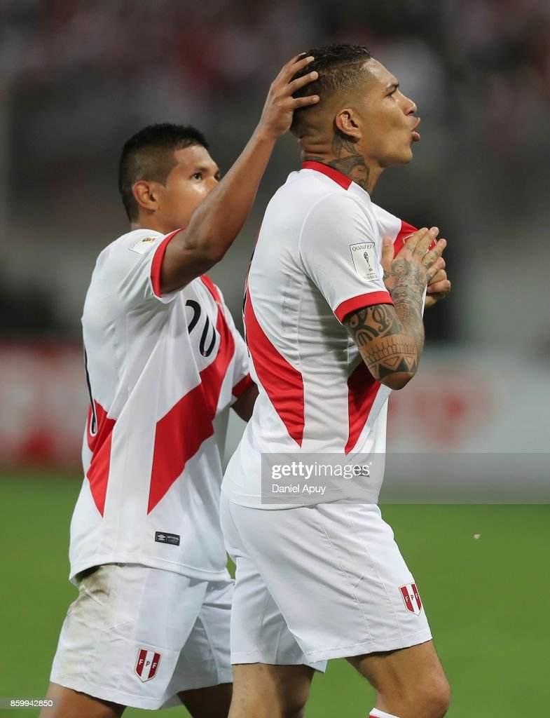 Paolo Guerrero of Peru celebrates with teammate Edison Flores after scoring the first goal of his team during a match between Peru and Colombia as part of FIFA 2018 World Cup Qualifiers at Monumental Stadium on October 10, 2017 in Lima, Peru.
