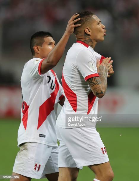 Paolo Guerrero of Peru celebrates with teammate Edison Flores after scoring the first goal of his team during a match between Peru and Colombia as...
