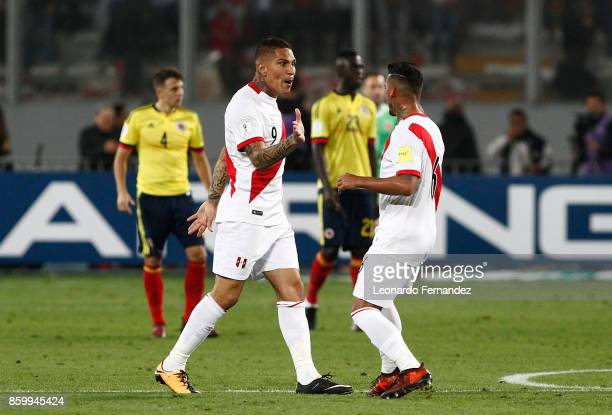 Paolo Guerrero of Peru celebrates with teammate Miguel Trauco after scoring the first goal of his team during match between Peru and Colombia as part...