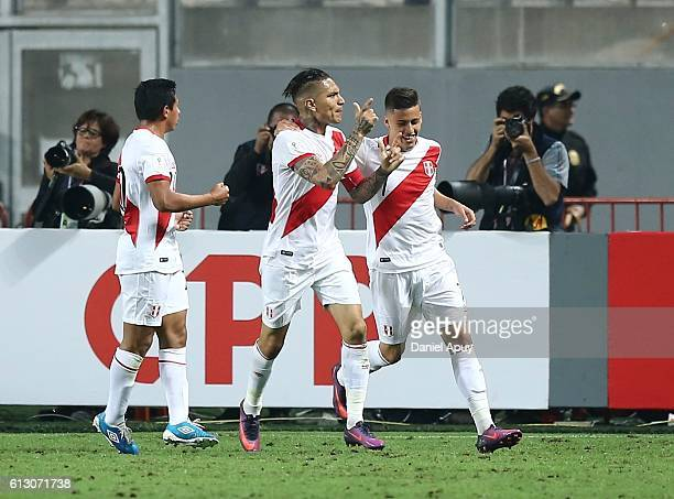 Paolo Guerrero of Peru celebrates with teammates Edison Flores and Alberto Da Silva after scoring the first goal of his team during a match between...