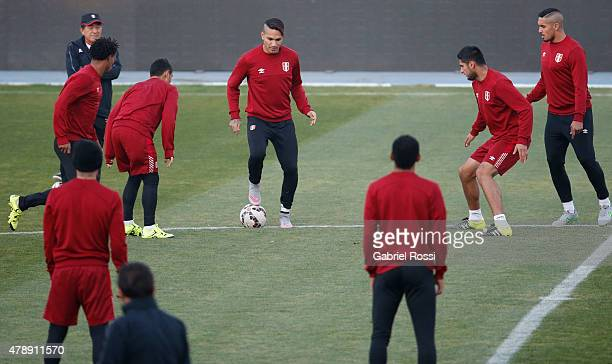 Paolo Guerrero of Peru controls the ball during a field scouting prior to the semi final match against Chile at Nacional Stadium as part of 2015 Copa...