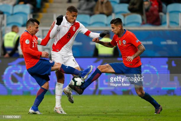 Paolo Guerrero of Peru fights for the ball with Gary Medel and Erick Pulgar of Chile during the Copa America Brazil 2019 Semi Final match between...