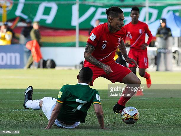 Paolo Guerrero of Peru fights for the ball with Juan Carlos Arce of Bolivia during a match between Bolivia and Peru as part of FIFA 2018 World Cup...