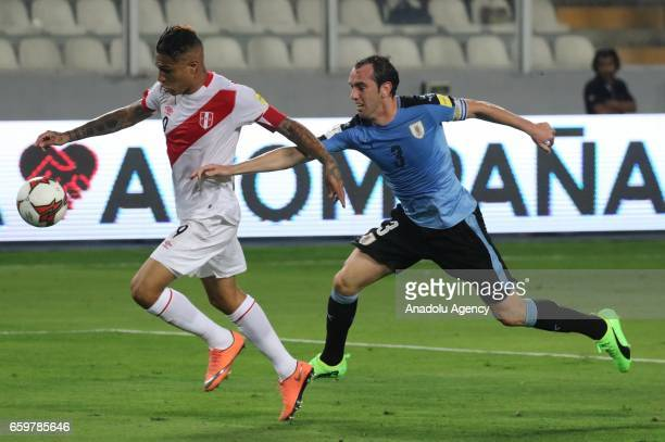 Paolo Guerrero of Peru in action against Diego Godin of Uruguay during 2018 FIFA World Cup Qualification match between Peru and Uruguay at National...